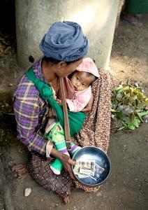 Beggar and Baby at Local Market in Bagan, Myanmar