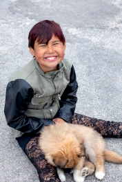 Inuit Girl and Puppy